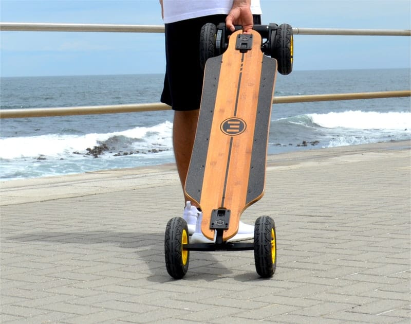 A person riding a skate board on a body of water
