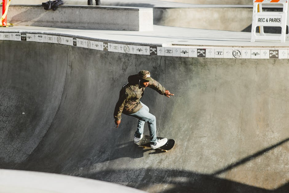 A man riding a skateboard up the side of a ramp