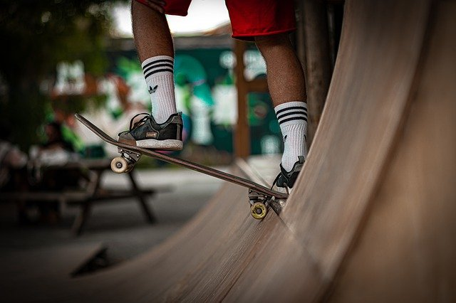 A close up of a person riding a skate board